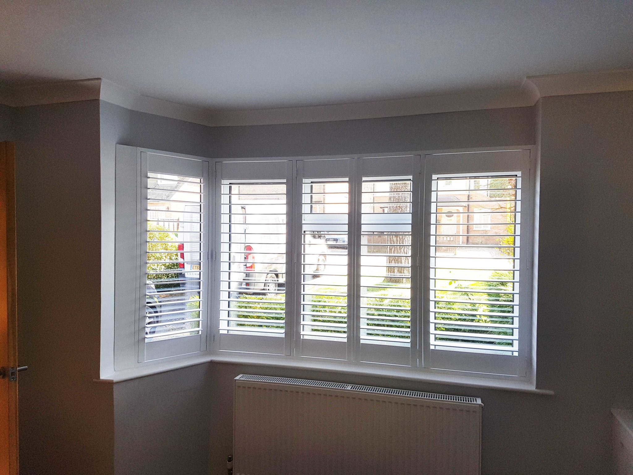 Interior Window Shutters In A L Shape Bay Window In A