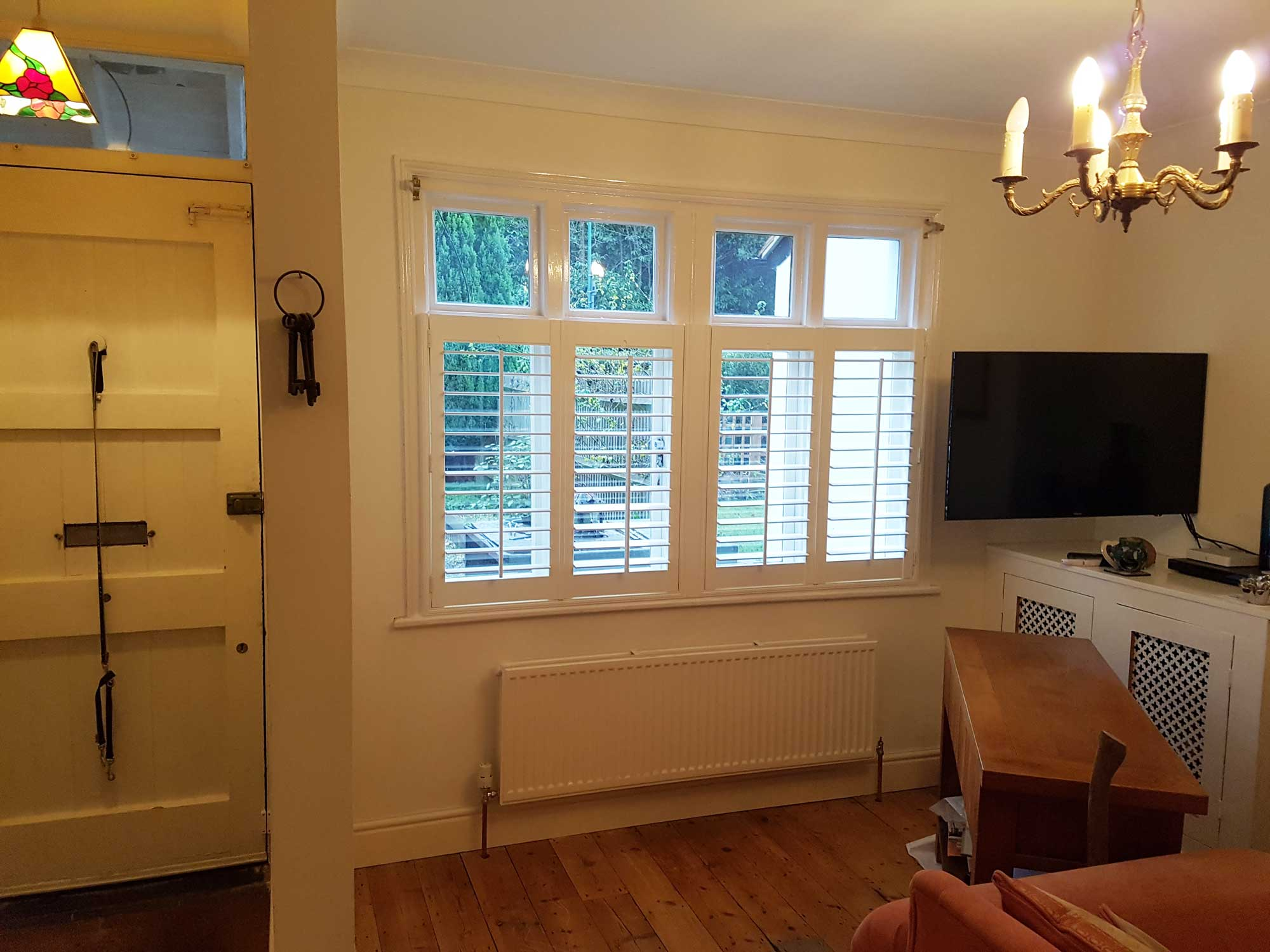 Bespoke Cafe Style Window Shutters In Living Room Of A